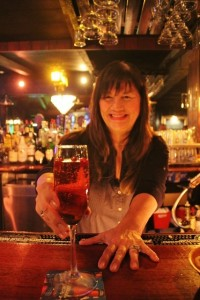 Champagne Cocktails served by our favorite bartender Mary. Lamarca Pointsetta a splash of cranberry juice and fresh cranberries soaked in Grand Mernier.